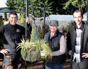 "The Garden Corner owner Jonn ""J-dog"" Karsseboom (left) poses with employees Karen ""K.T."" Tasker and Ryan ""Sting"" Krueger. The nicknames are part of the retailer's unconventional culture, which differentiates the garden center and helps establish rapport with customers. Photo by Curt Kipp"