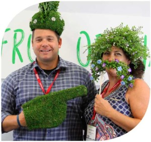 Attendees Adam Underwood and Breane Merritt of Van Belle Nursery dressed up with greenery at the Farwest Show photo booth.