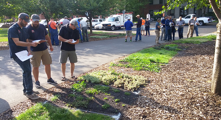 IPM coordinators and school grounds employees rate the plants during an IPM Coordinators Training at OSU's main campus in Corvallis, Oregon.