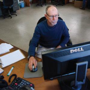 Tom Cammarota of Peoria Gardens works on a computer.